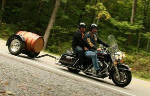 wood barrel motorcycle trailer behind Harley