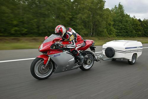 sport motorbike pull behind motorcycle trailer going fast