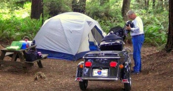 camping with a pull behind motorcycle trailer